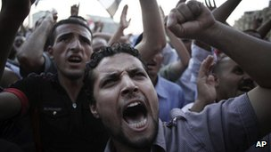 Men shout slogans denouncing Egypt's Supreme Council of the Armed Forces (Scaf) in Cairo (21 June 2012)