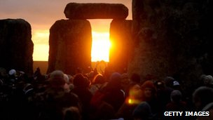 Sun rising at Stonehenge