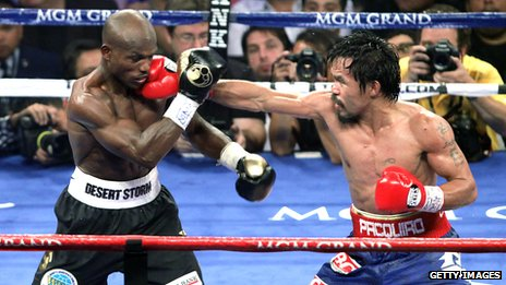 Manny Pacquiao punches Timothy Bradley