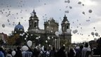 People release balloons during a ceremony marking the commemoration of the National Day on Enforced Disappearances held in Guatemala City