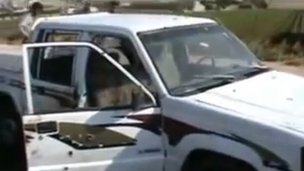 Screengrab from video purportedly showing killings in Darat Izza (22 June 2012)