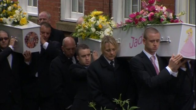 Coffins going into the church.