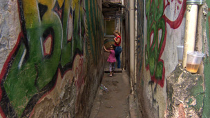 Mother and daughter in a narrow alley