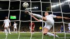 England&#039;s Ashley Cole watches as John Terry clears the ball from the goal mouth against Ukraine in Donetsk.
