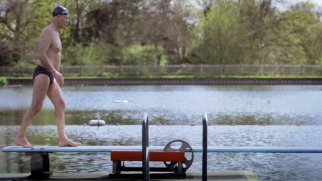 A man jumping into Hampstead Heath's bathing ponds