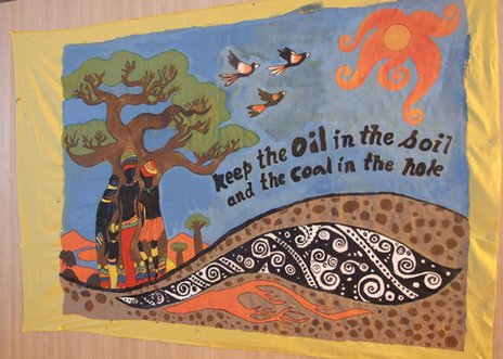 "Banner at Rio: ""Keep the oil in the soil, keep the coal in the hole"""