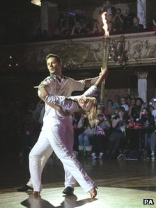 Harry Judd and dancer Aliona Vilani dance the flame across the ballroom