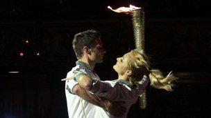 Harry Judd and dancer Aliona Vilani dance the flame across the ballroom
