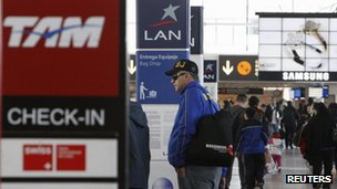 "Brazil's Tam and Chile's Lan airlines"" check-in signs are seen at Santiago's International Airport"