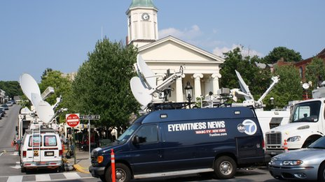 News trucks outside the courthouse in Bellefonte, Pennsylvania 22 June 2012