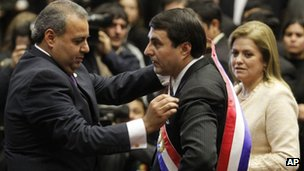"Congressional President Jorge Oviedo Matto, left, places the presidential sash on Paraguay""s former Vice President Federico Franco"