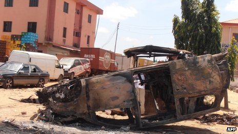 A photo taken on 18 June 2012 shows a car vandalised in revenge attacks after a church was bombed in Kaduna on Sunday