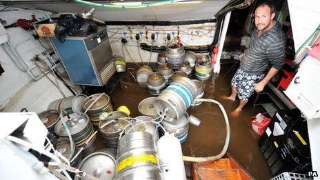Jon Lilley in the flooded cellar of his pub