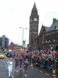 The Olympic flame passes Rochdale Town Hall
