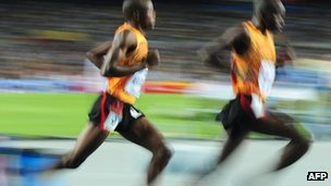 Uganda's Jacob Araptany and Uganda's Benjamin Kiplagat compete during the men's 3,000m steeplechase final at World Championships in Daegu on 1 September 2011