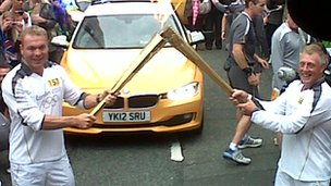 Chris Hoy carrying the torch in Manchester