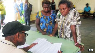 Voters names are checked in Kokopo, East New Britain province, Papua New Guinea, 23 June