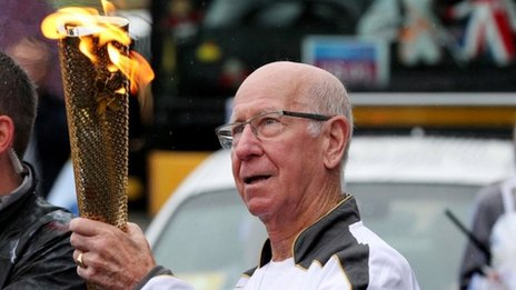 Sir Bobby Charlton carries the Olympic Torch