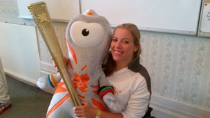 Hannah Cockroft with her torch and a friend
