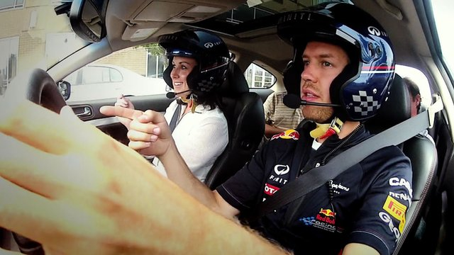 Sebastian Vettel takes Lee McKenzie for a drive