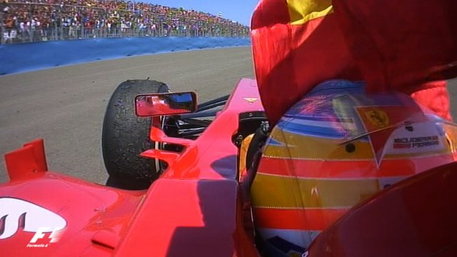 Ferrari's Fernando Alonso celebrates in front of the Spanish fans