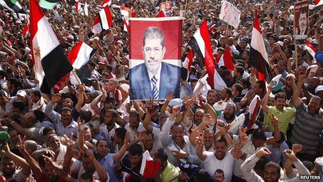 Supporters of Mohammed Mursi celebrate his victory in Tahrir Square