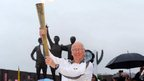 Sir Bobby Charlton in front of the Trinity statue