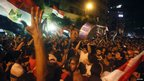 Muslim Brotherhood supporters celebrate into the evening