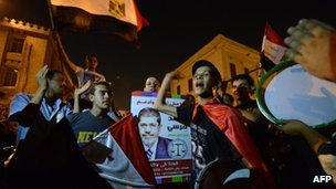 Egyptians celebrate the victory of the Muslim Brotherhood' s candidate, Mohammed Mursi (portrait), in Egypt's presidential elections