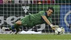 Gianluigi Buffon saves a penalty