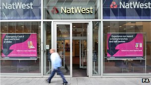 Customer walks past NatWest