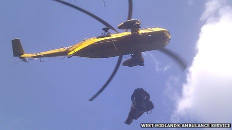 Man being winched into a helicopter, image by West Midlands Ambulance Service