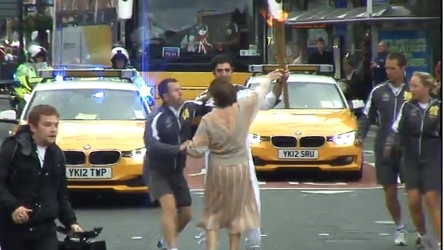 Woman attempts to touch Olympic torch in Leeds