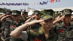South Korean soldiers salute the national flag during a ceremony marking the 62nd anniversary of the outbreak of the 1950-53 Korean War in Seoul, 25 June 2012