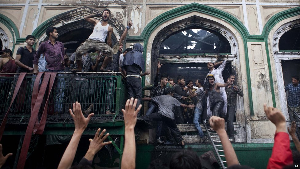 Protests began after fire destroyed a highly revered Sufi-shrine in downtown Srinagar.