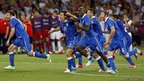 Italian players celebrate after winning the penalty shootout