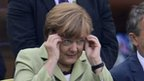 Angela Merkel watches the Germany vs Greece match