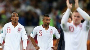 Ashley Cole and Ashley Young of England look dejected after defeat during the UEFA EURO 2012 quarter final match between England and Italy