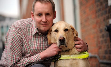 Damon Rose with his guide dog Beckett