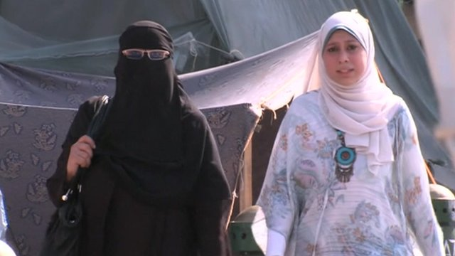 Two women walking in Cairo's Tahrir Square