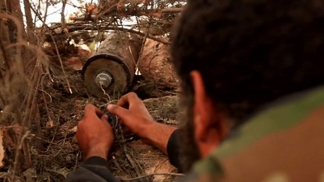 Syrian rebel fighter plants an IED