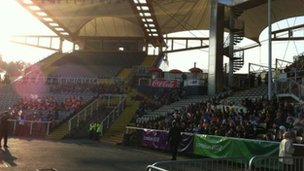 Schoolchildren await the torch in the Don Valley Stadium