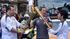 Simon Brown passes the flame to Sadaharu Mishina
