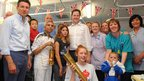 Deputy Prime Minister Nick Clegg and Seb Coe with the Olympic flame at Sheffield Children's Hospital