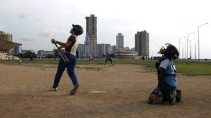 Cuban children play baseball