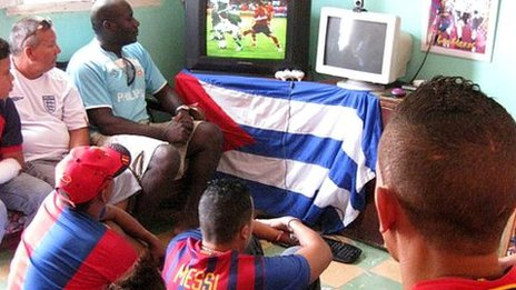 Cubans watch a football game