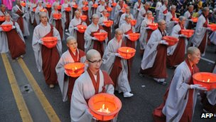 South Korean Buddhists march with lanterns during the Lotus Lantern Festival in downtown Seoul, 19 May 2012