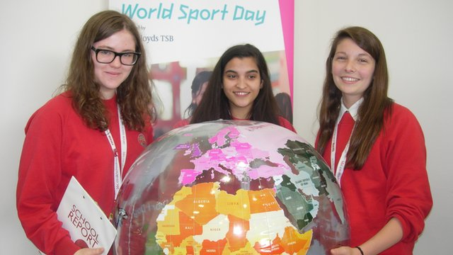 School Reporters with World Sports Day globe