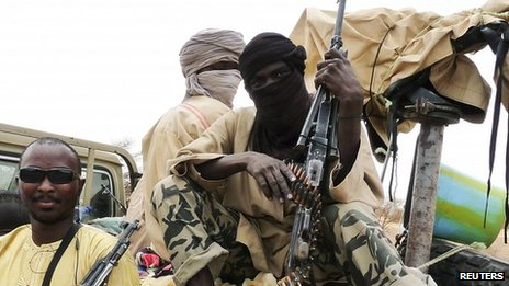 Ansar Dine militants pose in the northern Malian city of Gao on 18 June 2012