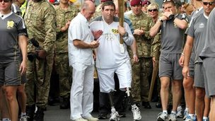 Ben Parkinson with the torch